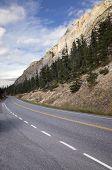 Mountain Road Under Majestic Rocky Cliffs