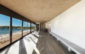 Architecture, beautiful house by the sea, empty room with large windows