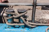 stock photo of bollard  - close up shot of a big bollard with a rope tied to it - JPG