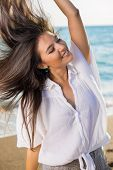 Dancing Woman With Flying Hair At The Beach