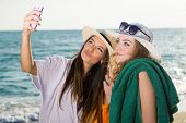 Pretty Women At The Beach Taking Selfie