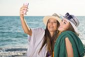 Pretty Girls At The Beach Taking Selfie