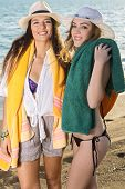 Smiling Girls With Their Towels At The Beach