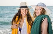 Pretty Women In Summer Hats At The Beach