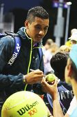 Professional tennis player Nick Kyrgios from Australia signing autographs after win at US Open 2014