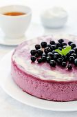 picture of cheesecake  - black currant cheesecake on a white plate - JPG