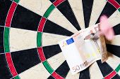 Dartboard With Steeldarts And Euro In It