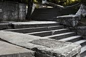 stock photo of bannister  - Ancient staircase in an abandoned park on a sunny day - JPG