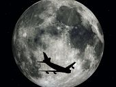 Airliner in front of the Moon