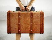 Men Holding Leather Suitcase