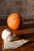 Baseball And Basketball With Dollars