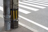 Electricity Post In Japan Beside A Crosswalk