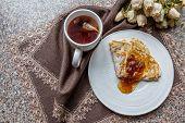 Baked Pancake With Jam And Hot Tea