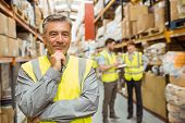 Portrait of smiling warehouse manager in a large warehouse