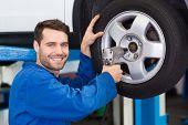 Mechanic adjusting the tire wheel at the repair garage
