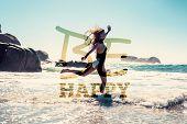 Beautiful smiling woman in white bikini skipping on the beach against be happy