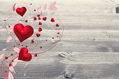 Valentines heart design against bleached wooden planks background