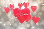 Valentines love hearts against shimmering light design on grey
