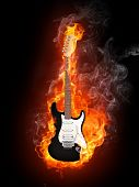 image of stratocaster  - Electric Guitar in fire Isolated on Black Background - JPG