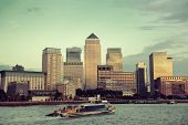 stock photo of canary  - Canary Wharf business district in London at sunset - JPG