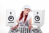 Close up Pretty Young Female, with White Cap and Headset, Mixing Music Using DJ Mixer between Two Stereos. Isolated on White Background.