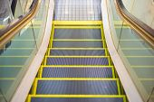 stock photo of escalator  - an escalator almost end to the floor - JPG