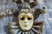 picture of venetian carnival  - A classical venetian carnival mask on wood - JPG