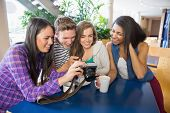 Young students looking at a camera at the university