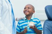 picture of false teeth  - Cropped dentist teaching young boy how to brush teeth - JPG