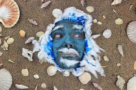 stock photo of poseidon  - Poseidon blue smiling face at the bottom of the sea - JPG