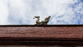 stock photo of apex  - Swan Gable Apex With Sky and art of a dragon - JPG
