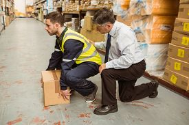 picture of warehouse  - Manager training worker for health and safety measure in a large warehouse - JPG