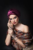 pic of muslimah  - beautiful woman in oriental style with mehendi in hijab - JPG