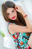 pic of freckle face  - Young beautiful woman brunette with long hair and green eyes - JPG