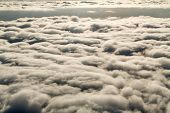 Постер, плакат: Look At The Clouds From The Airplane Above The Clouds
