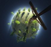 stock photo of crucifix  - Crucifix on a green planet - JPG