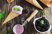 pic of blackberries  - ice cream in a waffle cone ripe blackberries and mint leaves on the table - JPG