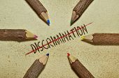 picture of racial discrimination  - Conceptual image with pencils on vintage background to stop discrimination - JPG