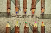 pic of racial discrimination  - Conceptual image with pencils on vintage background about discrimination - JPG