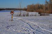 pic of shacks  - Tracks leading to ice fishing shack by ice rescue station - JPG