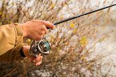 foto of fisherman  - Fisherman on the autumn background - JPG