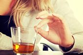stock photo of alcoholic drinks  - Yound beautiful woman in depression - JPG