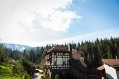 picture of twisty  - Mountain town house on a hill below the house a small mountain stream - JPG