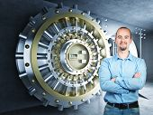 image of bank vault  - confident man and 3d bank vault background - JPG