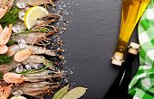 picture of tiger prawn  - Fresh prawns with spices and condiments on black stone background - JPG
