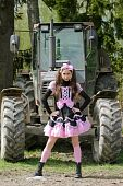 picture of lolita  - A girl in gothic lolita outfit posing ahead of tractor - JPG