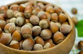 stock photo of cobnuts  - Hazelnuts in a wooden bowl on the table - JPG