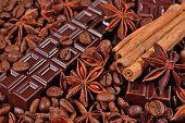 foto of cinnamon sticks  - Coffee chocolate star anise and cinnamon sticks background  - JPG