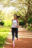 picture of sportive  - Sportive girl runner in a green summer park fitness training outdoors - JPG