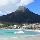 stock photo of lions-head  - Beautiful Camps Bay Beach and Lion Head Mountain Chain Cape Town South Africa - JPG